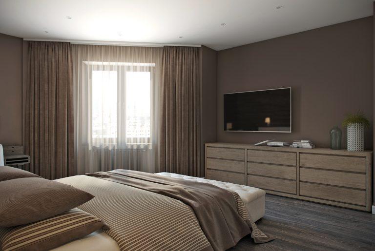 широкий комод в спальне