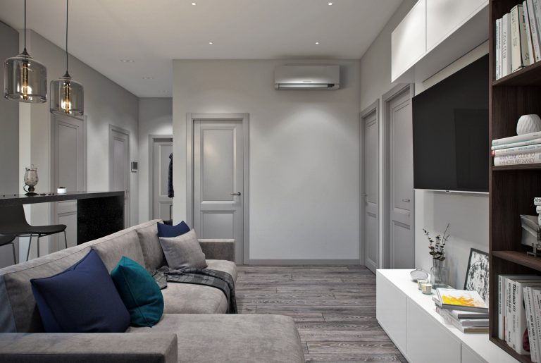 Зона просмотра ТВ в современной гостиной в серых тонах