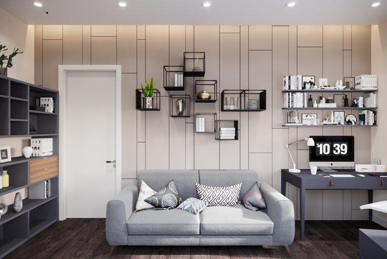 серый диван в домашнем кабинете