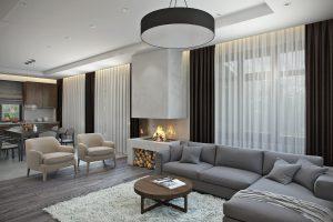 Просторная современная гостиная с дровяным камином в загородном доме