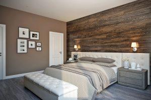 Кровать с широким мягким изголовьем и деревянной стеной