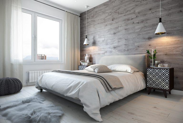 Светлая спальня с деревянной стеной у изголовья