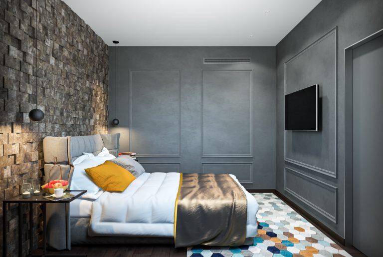 спальня с 3D-панелями у изголовья, декоративной штукатуркой и молдингами на стенах